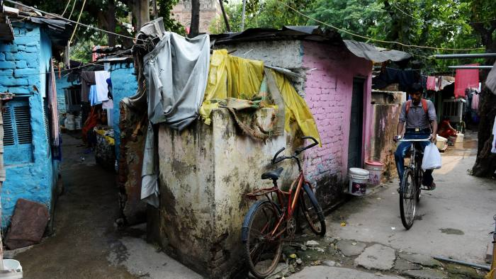 """To go with India-rape-court by Annie Banerji A view of a slum cluster at the R.K. Puram area, where the convicted gang rapists lived, in New Delhi on September 12, 2013. The gang all lived in and around Ram Dass Camp, an unauthorised slum in southern Delhi where former neighbours are among those who have been calling for their execution. Four men will learn September 13 whether they are to hang for the shocking murder and gang rape of an Indian student after her parents begged for the """"cold-blooded"""" killers' execution. AFP PHOTO/SAJJAD HUSSAIN (Photo credit should read SAJJAD HUSSAIN/AFP/Getty Images)"""