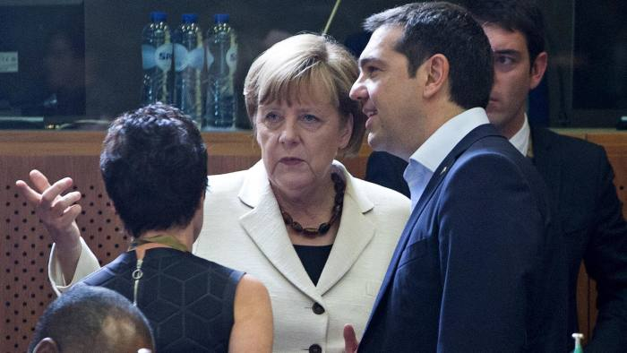 German Chancellor Angela Merkel (L) talks with Greek Prime Minister Alexis Tsipras (R) at the start of an EU-CELAC Latin America summit in Brussels, Belgium June 10, 2015. Tsipras had flown to Brussels to meet Merkel and French President Francois Hollande, with time fast running out for the two sides to agree on a cash-for-reforms deal for Greece. But it was not immediately clear whether that meeting would take place, with European Union officials saying Greece's latest offer had not gone far enough. REUTERS/Yves Herman