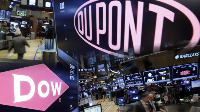 The company names of Dow, left, and Dupont, right, appear above their trading posts on the floor of the New York Stock Exchange, Wednesday, Dec. 9, 2015. Both pics by (AP Photo/Richard Drew) FT Montage