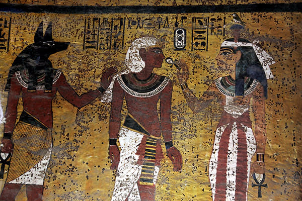 Facsimile of Tutankhamun flanked by Anubis (left) and Hathor on the south wall of the tomb