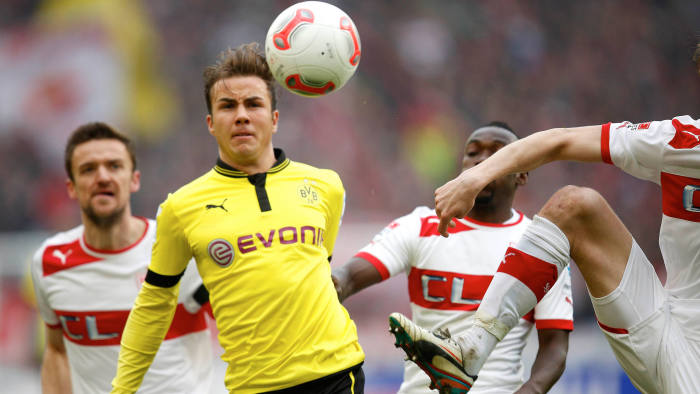 """File picture shows Borussia Dortmund's Mario Goetze (2nd L) as he challenges VfB Stuttgart's Christian Gentner (L) and VfB Stuttgart's Arthur Boka (3rd L) during their German first division Bundesliga soccer match in Stuttgart March 30, 2013. Borussia Dortmund confirmed April 23, 2013 that Goetze, one of the jewels of their youth academy, was set to join arch-rivals Bayern Munich in the summer, adding they were """"disappointed"""" at the news of the midfielder's departure. Picture taken March 30, 2013"""