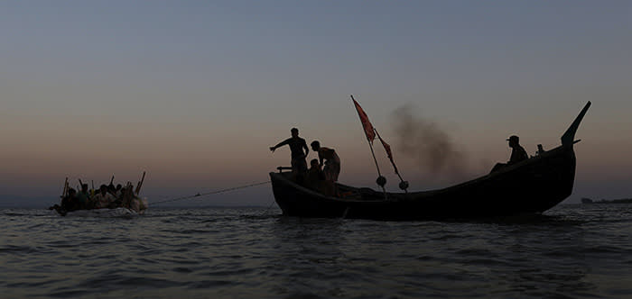 Rohingya refugees sailing on an improvised raft across the Naf river to reach Bangladesh are towed, in Teknaf, Bangladesh, November 29, 2017. REUTERS/Susana Vera TPX IMAGES OF THE DAY