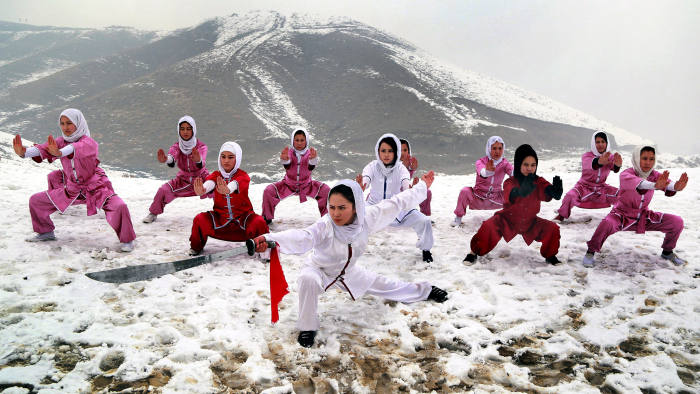epa05749199 Afghan girls from 'Shaolin Wushu Club' practice their skills during a training session, on the top of a hill in Kabul, Afghanistan, 25 January 2017. There are 20 Afghan girls learning Wushu skills at 'Shaolin Wushu club' in Kabul. From an age group of 14 to 20 years, the Afghan girls have been practicing this martial sport for almost two years. Seema Azimi runs the club with her father since 2015 to challenge gender bias in the conservative and war-torn country. As the only coach in her club, Azimi and other female trainees persist in practicing the Chinese martial arts every week on the top of the hill in winter. EPA/HEDAYATULLAH AMID