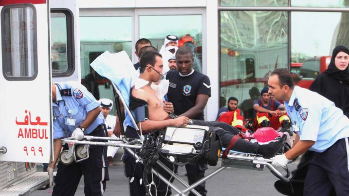 A survivor of a fire receives medical attention after a fire took hold of the Villaggio Mall, in Doha's west end, in the Qatari capital of Doha Monday May 28, 2012. Qatar's Interior Ministry said 13 children were among 19 people killed in a fire that broke out at one of the Gulf state's fanci