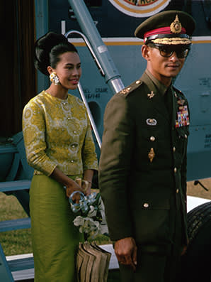 King Rama IX and Queen Sirikit have arrived to visit the victims of a recent flood in Hat Yai, Thailand. (Photo by Dean Conger/Corbis via Getty Images)