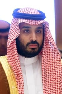 Saudi Defence Minister Mohammed bin Salman (2nd L), who is the desert kingdom's deputy crown prince and second-in-line to the throne, arrives at the closing session of the 4th Summit of Arab States and South American countries held in the Saudi capital Riyadh, on November 11, 2015. The summit is aimed to strengthen ties between the geographically distant but economically powerful regions. AFP PHOTO / FAYEZ NURELDINE (Photo credit should read FAYEZ NURELDINE/AFP/Getty Images)