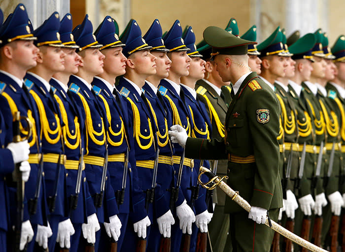 Members of the honor guard prepare before the meeting of Belarussian President Alexander Lukashenko with his Kazakh counterpart Nursultan Nazarbayev at the Independence Palace in Minsk, Belarus November 29, 2017. REUTERS/Vasily Fedosenko TPX IMAGES OF THE DAY