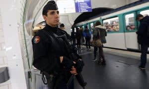 A French gendarme enforcing the Vigipirate plan, France's national security alert system, patrols on November 19, 2015 in a railway station Paris. France revealed on November 19 it will spend an extra 600 million euros (USD 641 million) next year to ramp up security after the Paris attacks. President Francois Hollande announced this week that France is freezing plans to cut troop numbers through 2019. At the same time, the country will add 8,500 law enforcement jobs including 5,000 new police. AFP PHOTO / THOMAS SAMSONTHOMAS SAMSON/AFP/Getty Images