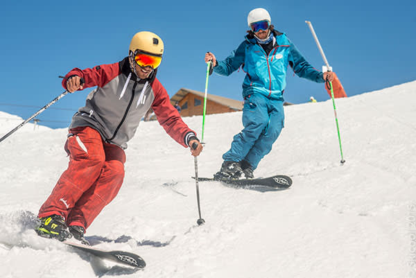 An instructor from Ski Cool leads a monoski lesson