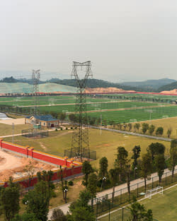 A few of Evergrande's 50 pristine football pitches