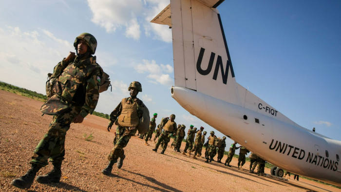 soldiers from Djibouti serving with the African Union Mission in Somalia (AMISOM) disembark from a United Nations aircraft at the airport in the central Somali town of Beledweyne