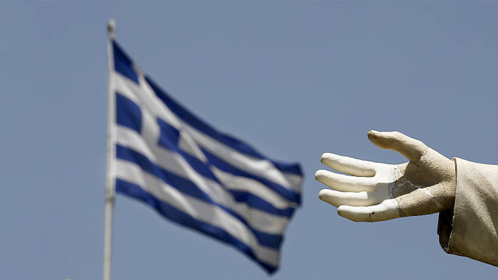 """A Greek flag flutters by the hand of a statue of former British Prime Minister William Ewart Gladstone in Athens June 17, 2015. The Greek central bank warned on Wednesday that the country would be put on a """"painful course"""" towards default and exiting the euro zone if the government and its international creditors failed to reach an agreement on an aid-for-reforms deal. REUTERS/Yannis Behrakis - RTX1GVXT"""