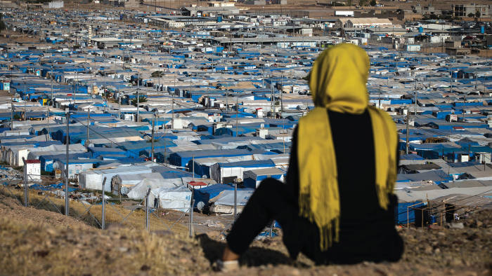 A woman looks out over the Kawergosk refugee camp, northern Iraq