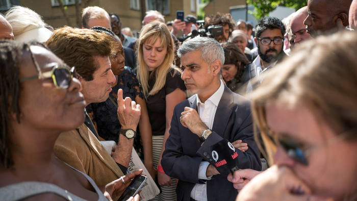 Picture shows residents talking with Mayor of London, Sadiq Khan.