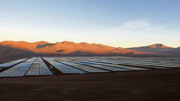 Solar panels of local mining company CAP, which were installed by SunEdison, are seen in the Atacama Desert in this June 5, 2014 file photo. REUTERS/Fabian Andres Cambero/Files - RTSCOGW