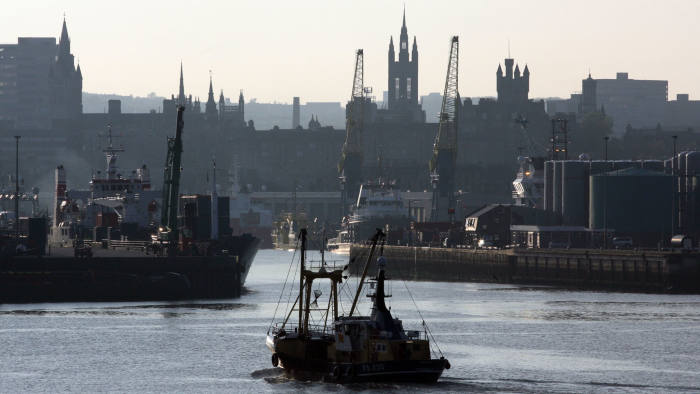 The harbour and skyline of Aberdeen, Scotland, UK, showing the city at early evening near dusk