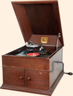 A large, antique gramophone from the early 1900s