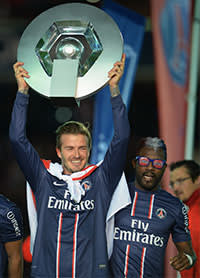 David Beckham lifts the Ligue 1 trophy