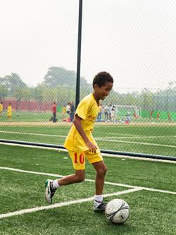 Wang Mu, a Chinese-Tanzanian student at Evergrande academy