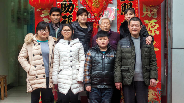 Outside the family's 'stewed meat' shop in Shennongjia: (back row, from left) Xiang Lihong, Xiang Ju, her mother and her sister-in-law. Front row, from left: daughters Xiang Qinqin and Xiang Qianqiu, Xiang Ju's nephew and Xiang Dong, her brother