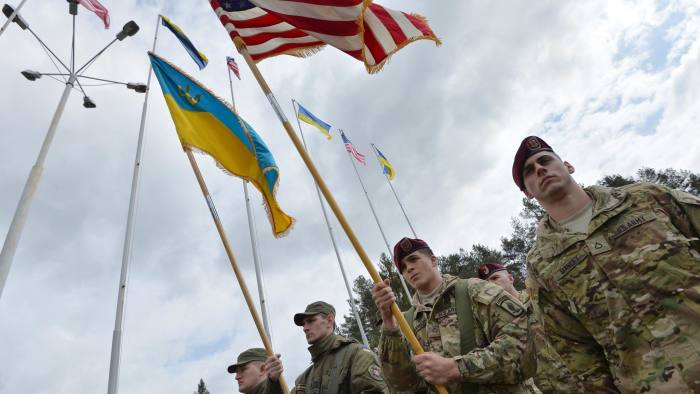 Ukrainian and US soldiers at the opening ceremony of a joint militrary exercise in the Lviv region