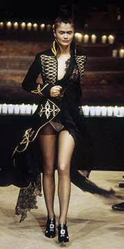 Helena Christensen in a military coat by  Alexander McQueen