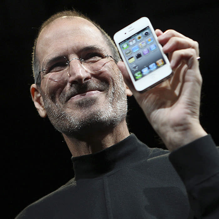 Apple CEO Steve Jobs poses with the new iPhone 4 during the Apple Worldwide Developers Conference in San Francisco, California in this June 7, 2010 file photo