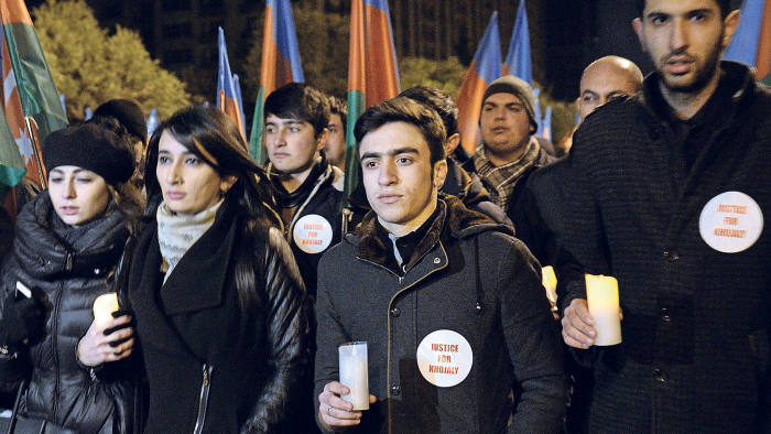 People carry lit candles as they gather in central Baku on February 25, 2015 to commemorate the Khojaly massacre in 1992 in which ethnic Azerbaijanis were killed by Armenians during the Nagorno-Karabakh Wa