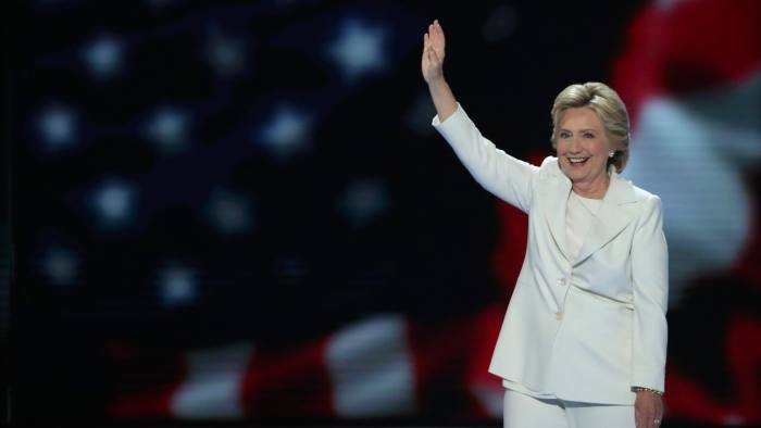PHILADELPHIA, PA - JULY 28: Democratic presidential nominee Hillary Clinton waves to the crowd as she arrives on stage during the fourth day of the Democratic National Convention at the Wells Fargo Center, July 28, 2016 in Philadelphia, Pennsylvania. Democratic presidential candidate Hillary Clinton received the number of votes needed to secure the party's nomination. An estimated 50,000 people are expected in Philadelphia, including hundreds of protesters and members of the media. The four-day Democratic National Convention kicked off July 25. (Photo by Alex Wong/Getty Images)