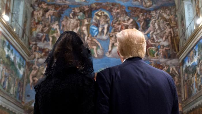 """This handout picture released by the Vatican press office shows US President Donald Trump (R) and US First Lady Melania Trump during a visit of the Sistine Chapel following a private audience with Pope Francis on May 24, 2017 at the Vatican. / AFP PHOTO / OSSERVATORE ROMANO AND AFP PHOTO / HO / RESTRICTED TO EDITORIAL USE - MANDATORY CREDIT """"AFP PHOTO / OSSERVATORE ROMANO"""" - NO MARKETING NO ADVERTISING CAMPAIGNS - DISTRIBUTED AS A SERVICE TO CLIENTS  HO/AFP/Getty Images"""