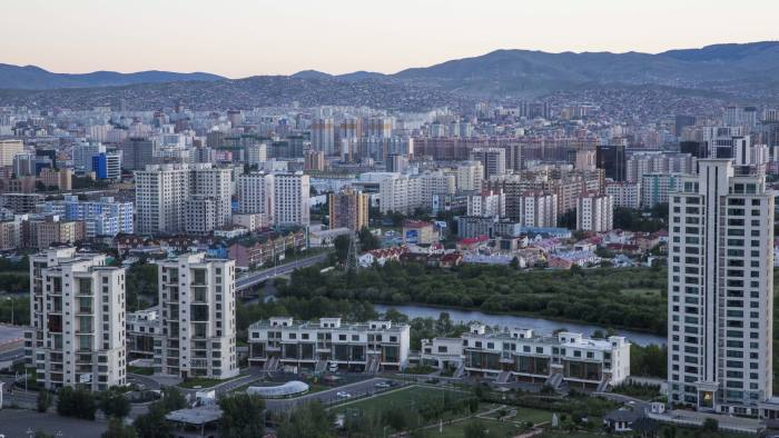 Buildings stand in Ulaanbaatar, Mongolia, on Monday, July 18, 2016. Mongolia's budget deficit widened to 1.12 trillion tugrik ($572 million) in the first six months of 2016 from a deficit of 535 billion tugrik ($281 million) in the same period a year earlier, according to data released on July 19 by the National Statistical Office. Photographer: Taylor Weidman/Bloomberg