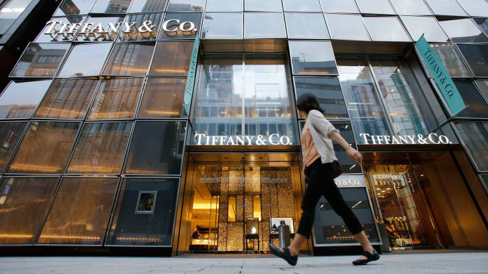 A woman walks past Tiffany Building at Tokyo's Ginza shopping district