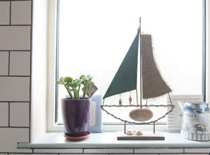A model boat in the bathroom, a reminder of the sea
