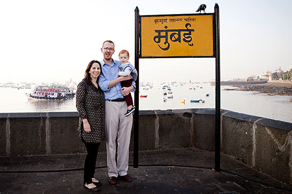 Mumbai, India- 12 March 2016: James, Mary and Alexander at Gateway of India next to a sign that says 'Mumbai'.