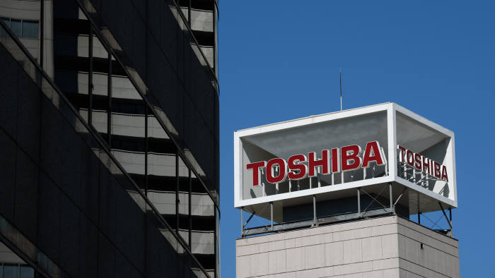 Signage for Toshiba Corp. is displayed at the company's headquarters in Tokyo, Japan, on Tuesday, July 21, 2015. Toshiba President Hisao Tanaka and two other executives quit to take responsibility for a $1.2 billion accounting scandal that caused the company to restate earnings for more than six years. Photographer: Akio Kon/Bloomberg