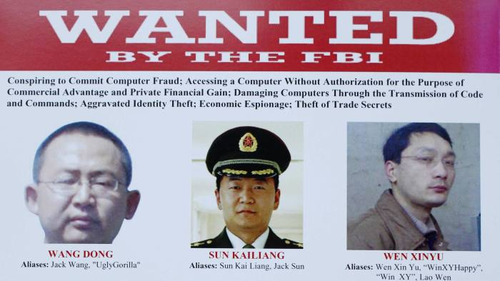 This wanted poster is displayed at the Justice Department in Washington, Monday, May 19, 2014, after Attorney General Eric Holder, Assistant Attorney General for National Security John Carlin, U.S. Attorney for Western District of Pennsylvania David Hickton and FBI Executive Associate Director Robert Anderson participated in a news conference where Holder announced that a U.S. grand jury has charged five Chinese hackers with economic espionage and trade secret theft, the first-of-its-kind criminal charges against Chinese military officials in an international cyber-espionage case. (AP Photo)