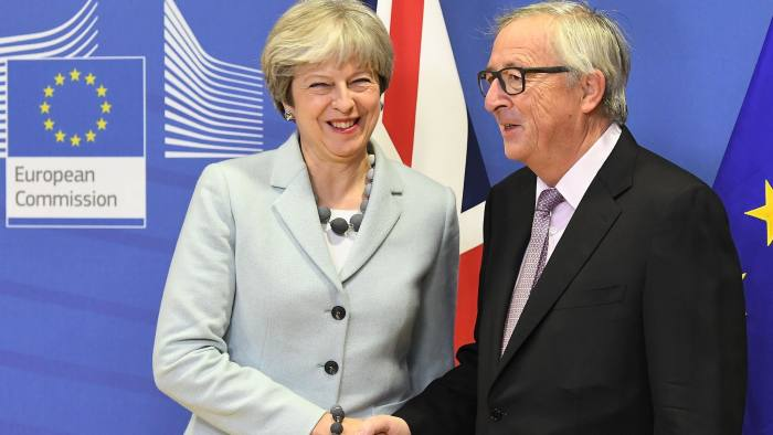 TOPSHOT - British Prime Minister Theresa May (L) is welcomed by European Commission Jean-Claude Juncker at European Commission in Brussels on December 8, 2017. / AFP PHOTO / EMMANUEL DUNANDEMMANUEL DUNAND/AFP/Getty Images