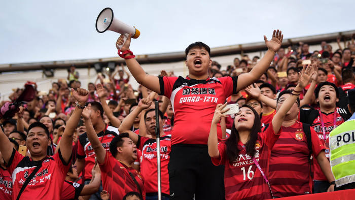 Fans of Guangzhou Evergrande cheer their team during their Chinese Super League (CSL) football match against Tianjin Quanjian in Guangzhou, in China's southern Guangdong province on November 4, 2017. Luiz Felipe Scolari thanked the Guangzhou Evergrande players and fans on November 4, after what is expected to be his final game in charge at the freshly crowned Chinese Super League (CSL) champions. / AFP PHOTO / STR / China OUT (Photo credit should read STR/AFP/Getty Images)