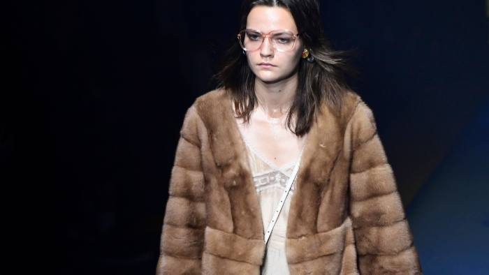 f51069652 A model wears a creation for Gucci in Milan last month. The company's fur- free policy comes into effect next year © AFP