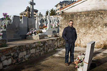 Emilio Silva, co-founder of the Association for the Recovery of Historical Memory, visits a Republican grave at Colmenar Viejo cemetery, north of Madrid