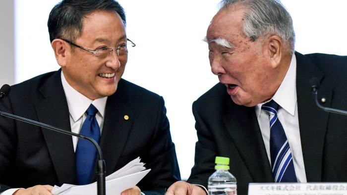 President of Toyota Motor Akio Toyoda (L) shares a laugh with Chairman of Suzuki Motor Osamu Suzuki (R) during a press conference at Toyota's head office in Tokyo on October 12, 2016. Toyota and Suzuki announced that it will consider the possibility of joint development of advanced technology. / AFP / TORU YAMANAKA (Photo credit should read TORU YAMANAKA/AFP/Getty Images)