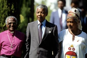 Tutu with Nelson Mandela and his then wife, Winnie