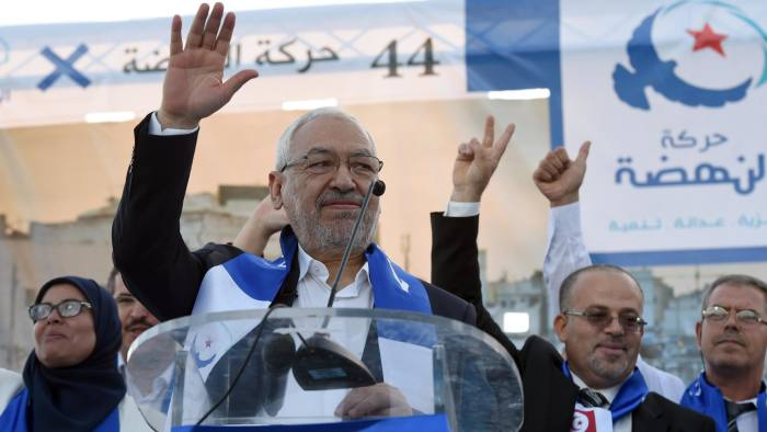 Tunisian Islamist Ennahda Party leader and founder Rached Ghannouchi (C) gestures as he gives a speech during a campaign rally on October 15, 2014 in Bizerte, north-east of Tunis, ahead of the country's parliamentary elections. Campaigning officially began on October 4, 2014 for Tunisia's October 26 parliamentary election, with 13,000 candidates vying for places in the 217-seat National Assembly. AFP PHOTO / FETHI BELAID (Photo credit should read FETHI BELAID/AFP/Getty Images)