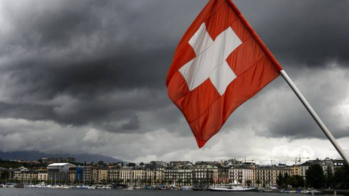 A Swiss flag flies on the shores of Geneva Lake on June 14, 2013 in the center of Geneva. AFP PHOTO / FABRICE COFFRINI (Photo credit should read FABRICE COFFRINI/AFP/Getty Images)