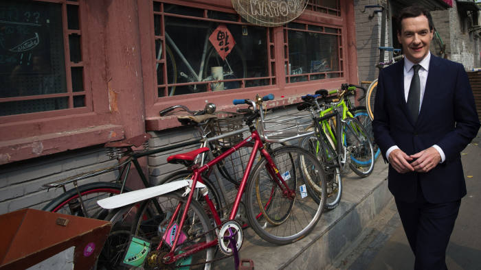 Chancellor of the Exchequer George Osborne walks though a Hutong, a traditional Chinese alleyway in Beijing, China, where he met local people and traders, as Britain must become China's 'best partner in the West', Osborne said as he arrived in Beijing, embarking a week long visit. PRESS ASSOCIATION Photo. Picture date: Sunday September 20, 2015. See PA story POLITICS Osborne. Photo credit should read: Stefan Rousseau/PA Wire