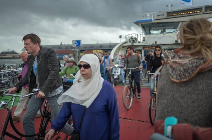Commuters travel by ferry from the centre of Amsterdam to Amsterdam North: next year a new metro stop will link the borough to the rest of the city