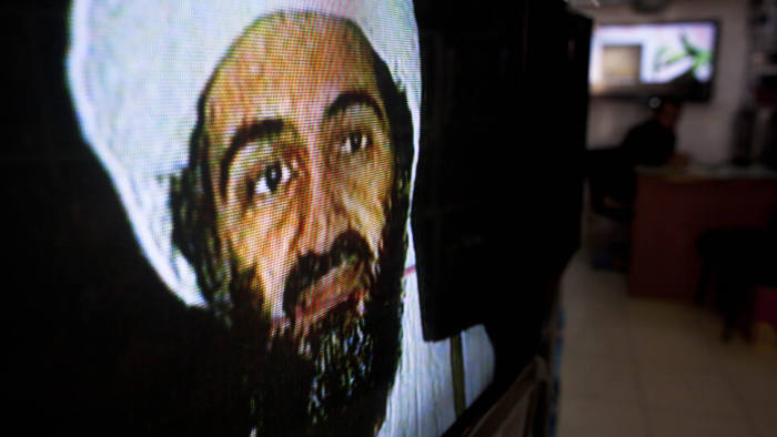 Afghans watch television coverage announcing the killing of Al-Qaeda leader Osama bin Laden at an electronics store on May 2, 2011 in Kabul, Afghanistan. Bin Laden has been killed near Islamabad, Pakistan almost a decade after the terrorist attacks of Sept. 11, 2001 and his body is in possession of the United States.