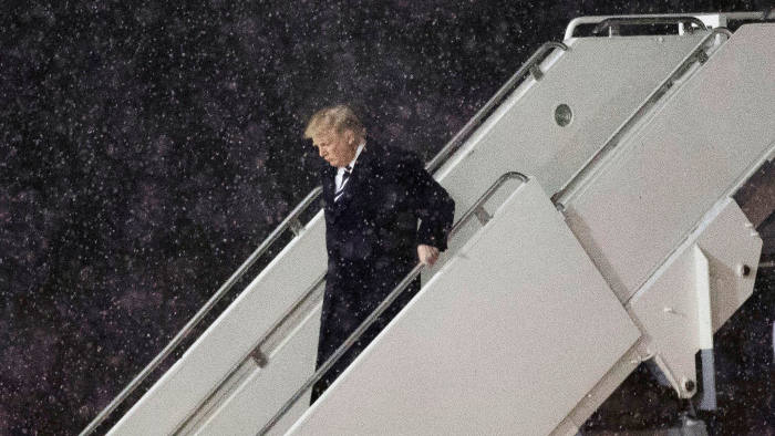 President-elect Donald Trump departs his plane at Gerald R. Ford International Airport, December 9, 2016 in Grand Rapids, Michigan.