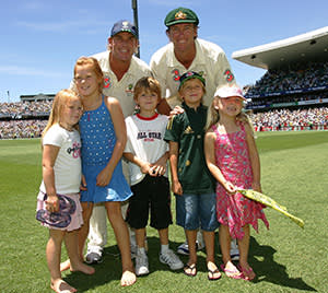 Shane Warne with fellow Australian cricketer Glenn McGrath and the players' children at an Ashes Test in 2007
