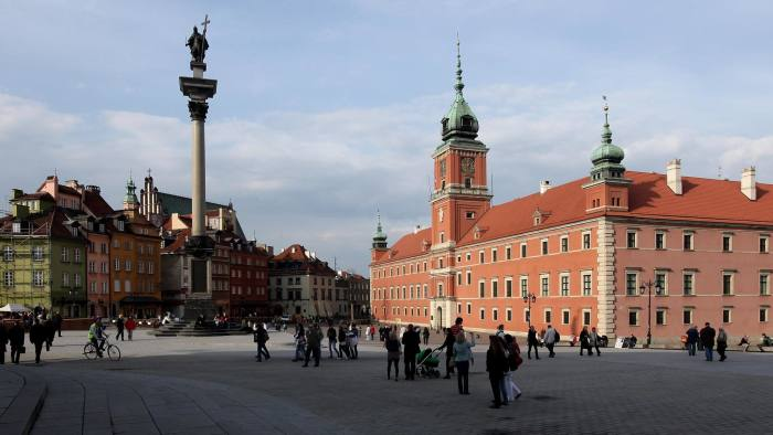 WARSAW, POLAND - APRIL 12:  People walk across Zamkowy Square by Krolewski Palace (R) and Zygumnt's Column at the entrance to the city's Old Town on April 12, 2010 in Warsaw, Poland. Warsaw is a popular tourist destination in eastern Europe.  (Photo by Sean Gallup/Getty Images)